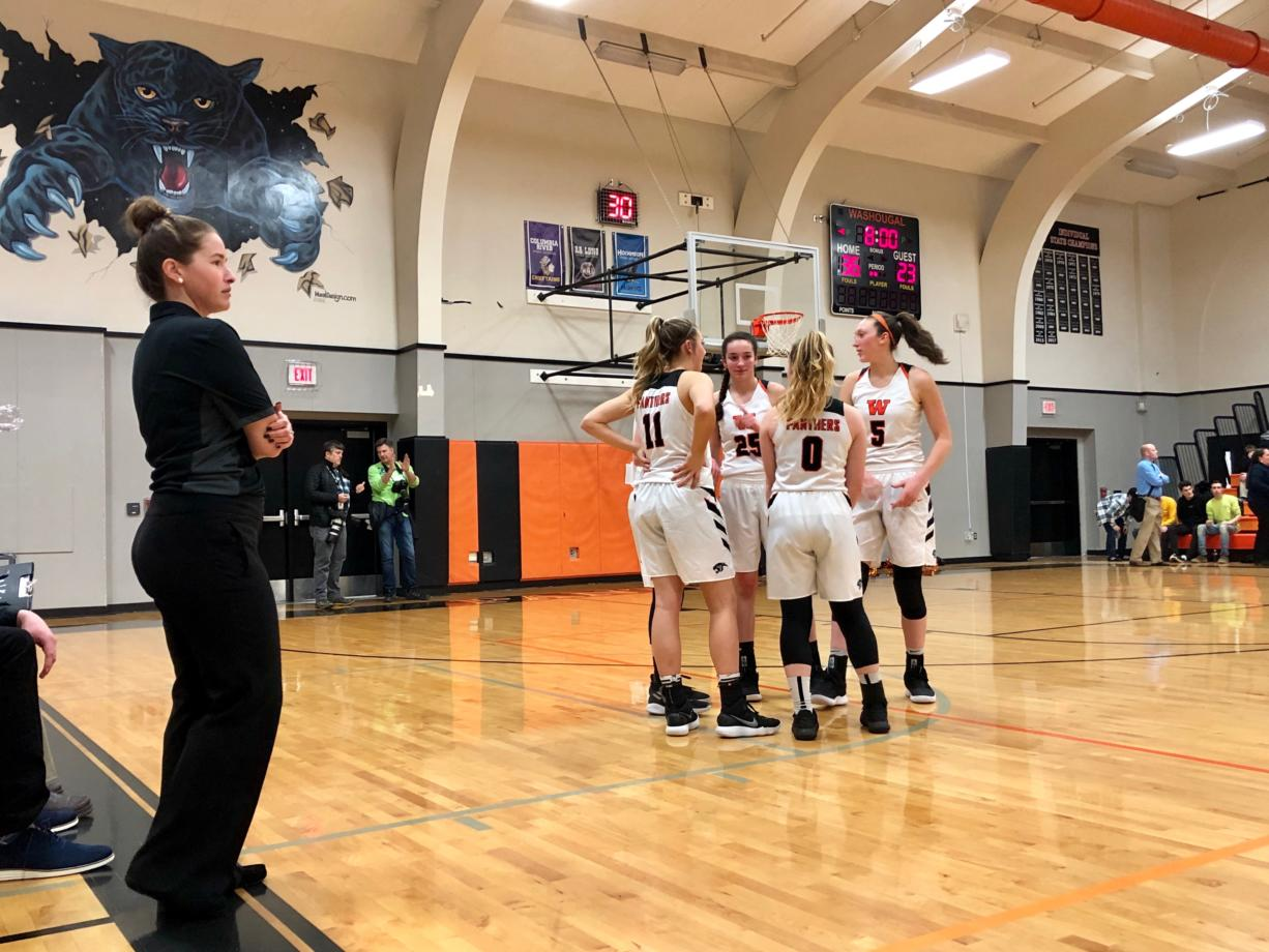 The Washougal girls basketball team prepares to take the floor for the second half of a 71-39 league title-clinching win over Woodland on Thursday night at Woodland High School. (Andy Buhler/The Columbian)