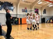The Washougal girls basketball team prepares to take the floor for the second half of a 71-39 league title-clinching win over Woodland on Thursday night at Woodland High School.