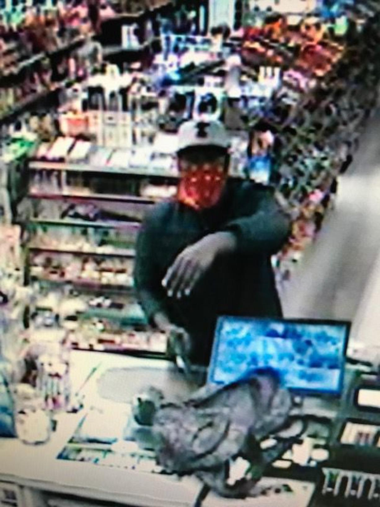 The man suspected of fatally shooting an employee during a robbery at Holt's Quik Chek in Kelso.