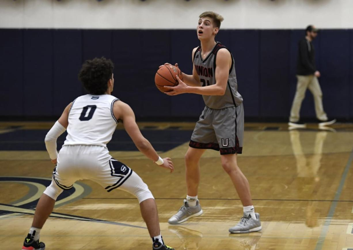 Union's Tanner Toolson (21) has been described by Union coach Blake Conley as the Titans' X-factor for his versatility on the court. Alisha Jucevic/The Columbian