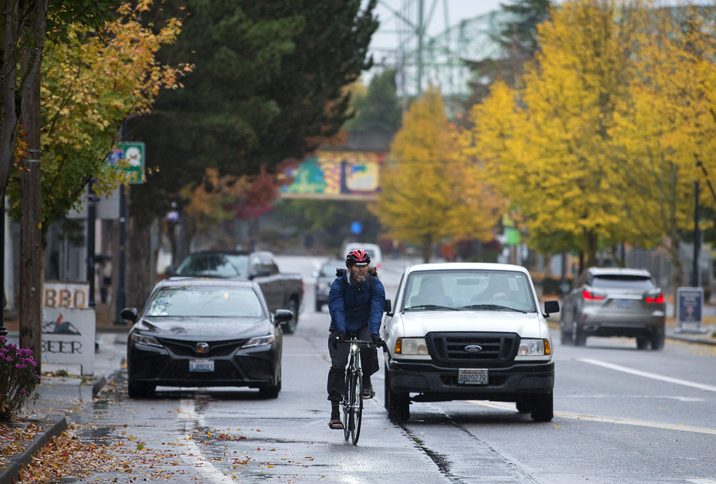 A Cyclist Navigates Through Traffic In Downtown Vancouver Late 2018 S Westside Mobilit