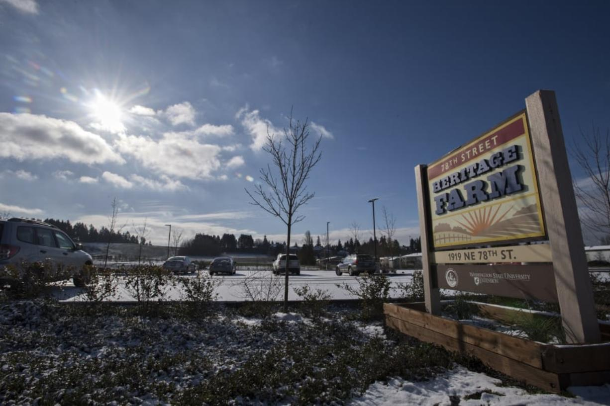 Winter sun illuminates the sign Tuesday morning at the 78th Street Heritage Farm, which is upgrading its outdated master plan and soliciting advice from the community about how it should operate in the future.