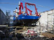 Repairs are done to a ship on the dry docks at Vigor on Swan Island in Portland.