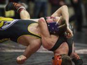 Battle Ground's Daniel Joner has a lock on Hanford's Braeden Nalle in the first-round match of the 126-pound bracket at 4A regional wrestling tournament at Camas High School on Friday. Joner pinned Halle in 1 minute, 50 seconds.