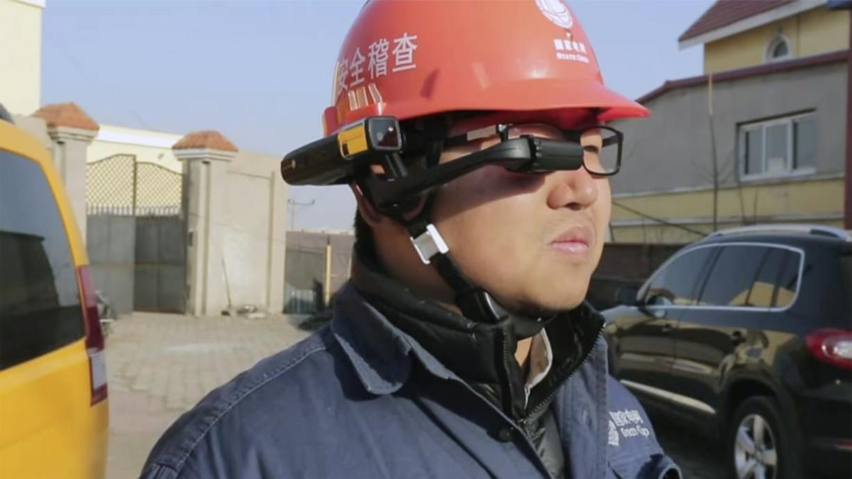 A State Grid worker looks at the screen on a RealWear HMT-1 headset.