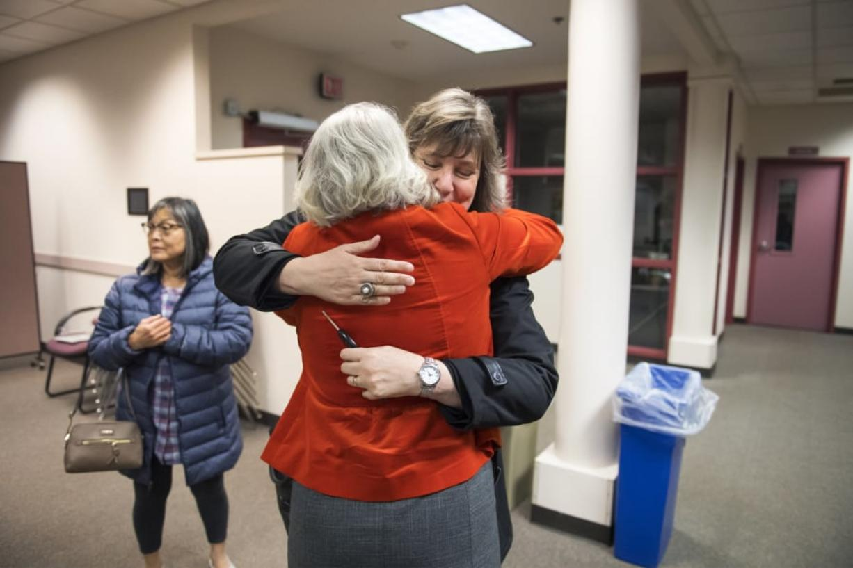 Tamara Shoup, interim executive director for school supports, center left, and Christina Iremonger, chief digital officer, hug in celebration after hearing election results at the Vancouver Public Schools district offices on Tuesday night. Both the educational fund and technology levies were passing with wide margins after initial results were released.