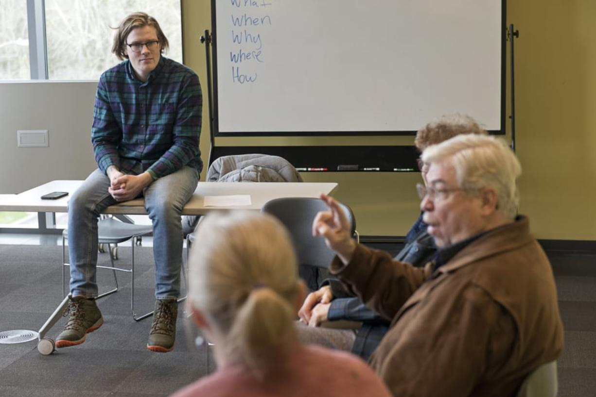 Instructor Rob Nyczaj watches former American Sign Language teacher Doug Kennedy discuss his afternoon Sunday during a conversation circle at the Vancouver Community Library.