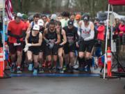 Runners start the Vancouver Lake Half Marathon on Sunday morning, February 24, 2019.