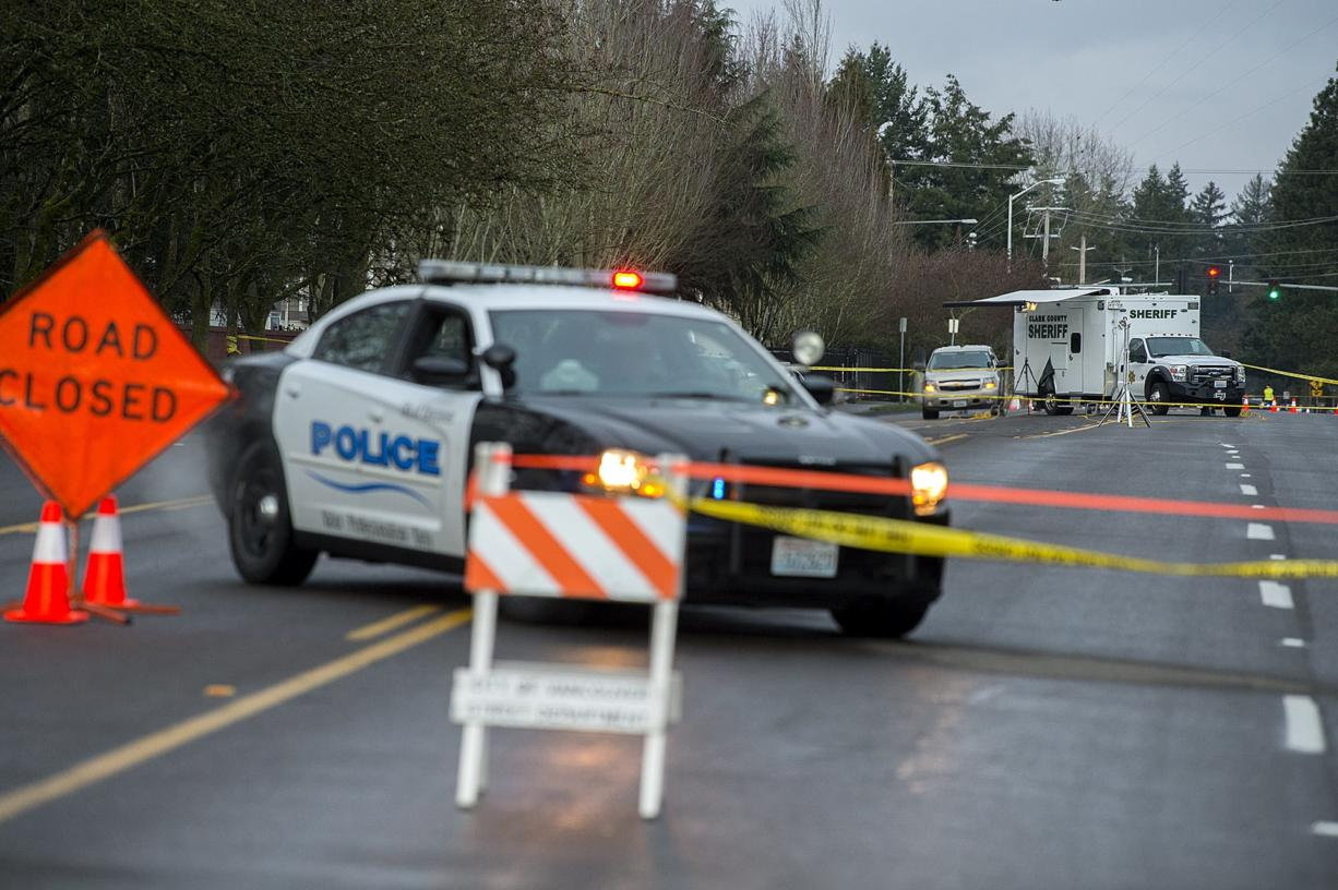 Officials investigate the scene of an officer-involved shooting on Southeast 10th Street on Wednesday morning, Feb. 20, 2019. (Amanda Cowan/The Columbian)