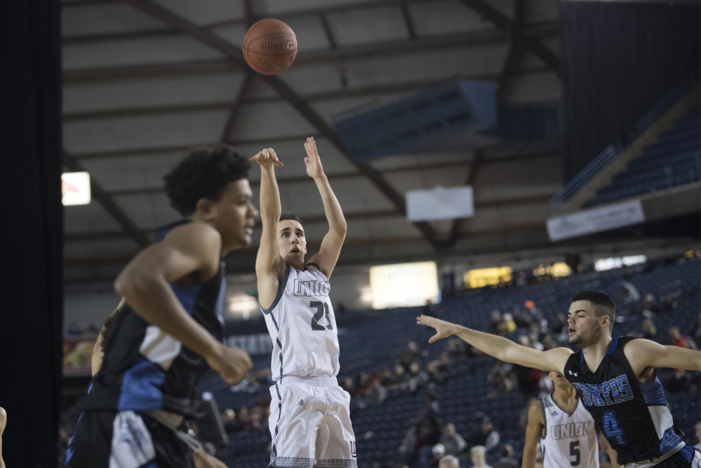 3730b7e803d9d3 Union s Ethan Smith shoots against Curtis during the 4A Hardwood Classic at  the Tacoma Dome on