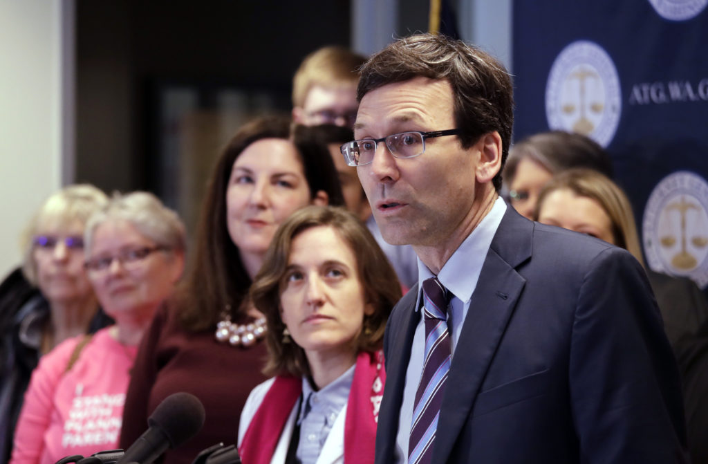 Washington state Attorney General Bob Ferguson speaks at a news conference announcing a lawsuit chal