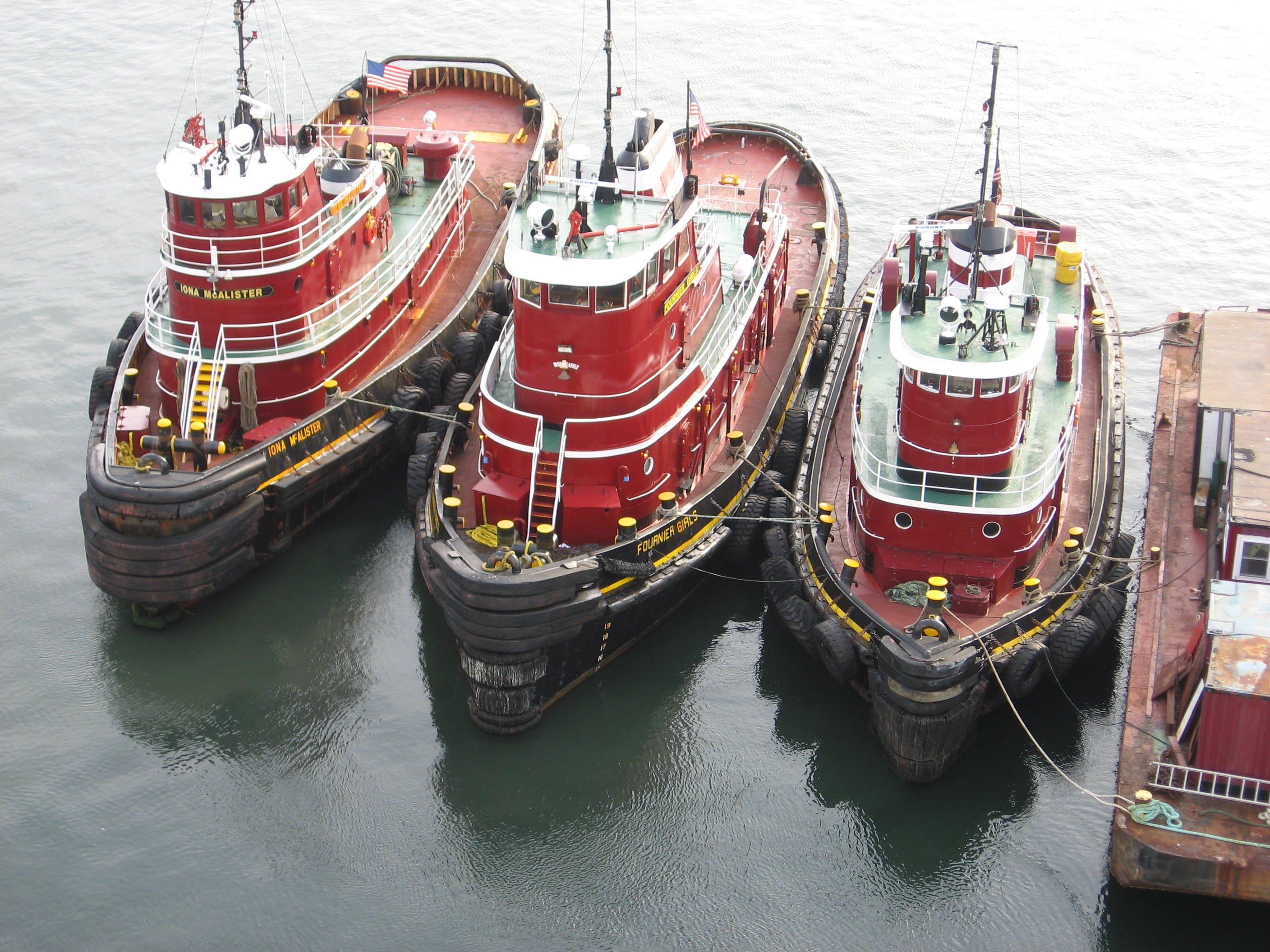 Tugs at Prince Edward Island by Larry Juday