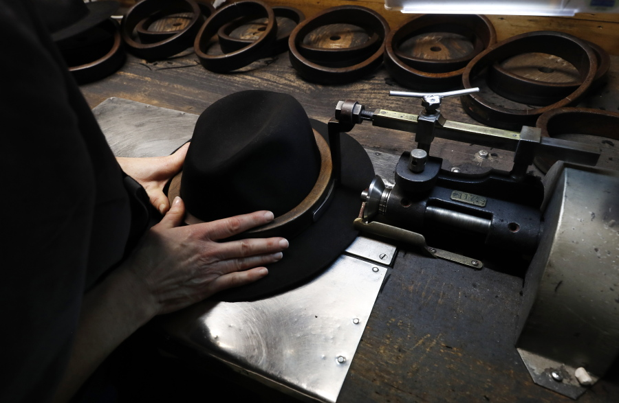 11a5cdd7 A man holds a hat inside the Borsalino hat factory, in Spinetta Marengo,  near