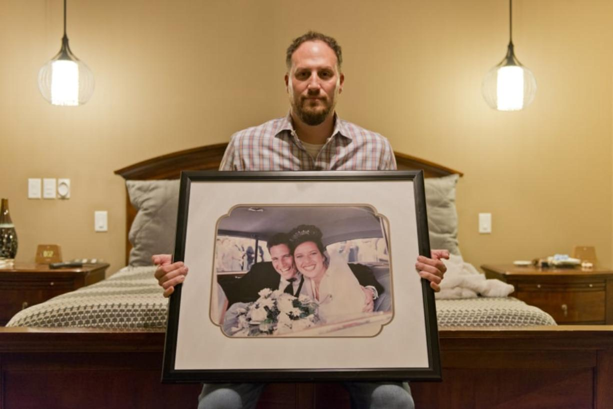 Andy Miller with a photo of his wedding day about 20 years ago when he married Jaime Miller. Jaime Miller, who was known as the life of every party, had a piece of legislation crafted in her honor and an endowment fund named after her announced this week. The Columbian files