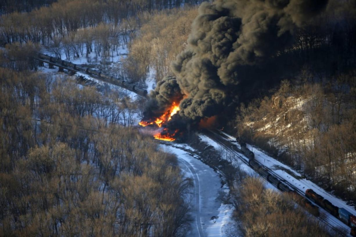 Smoke and flames erupt from an oil train derailment in 2015 near Galena, Ill. A new rule announced Thursday is aimed at having crews and equipment ready in the event of an accident.