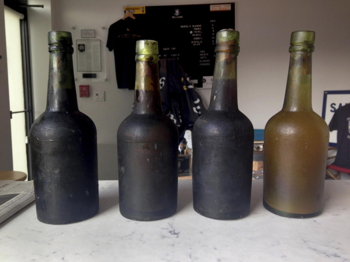 Four bottles recovered from the SS Oregon, a 133-year-old shipwreck, are shown in 2017 at the Saint James Brewery in Holbrook, N.Y.