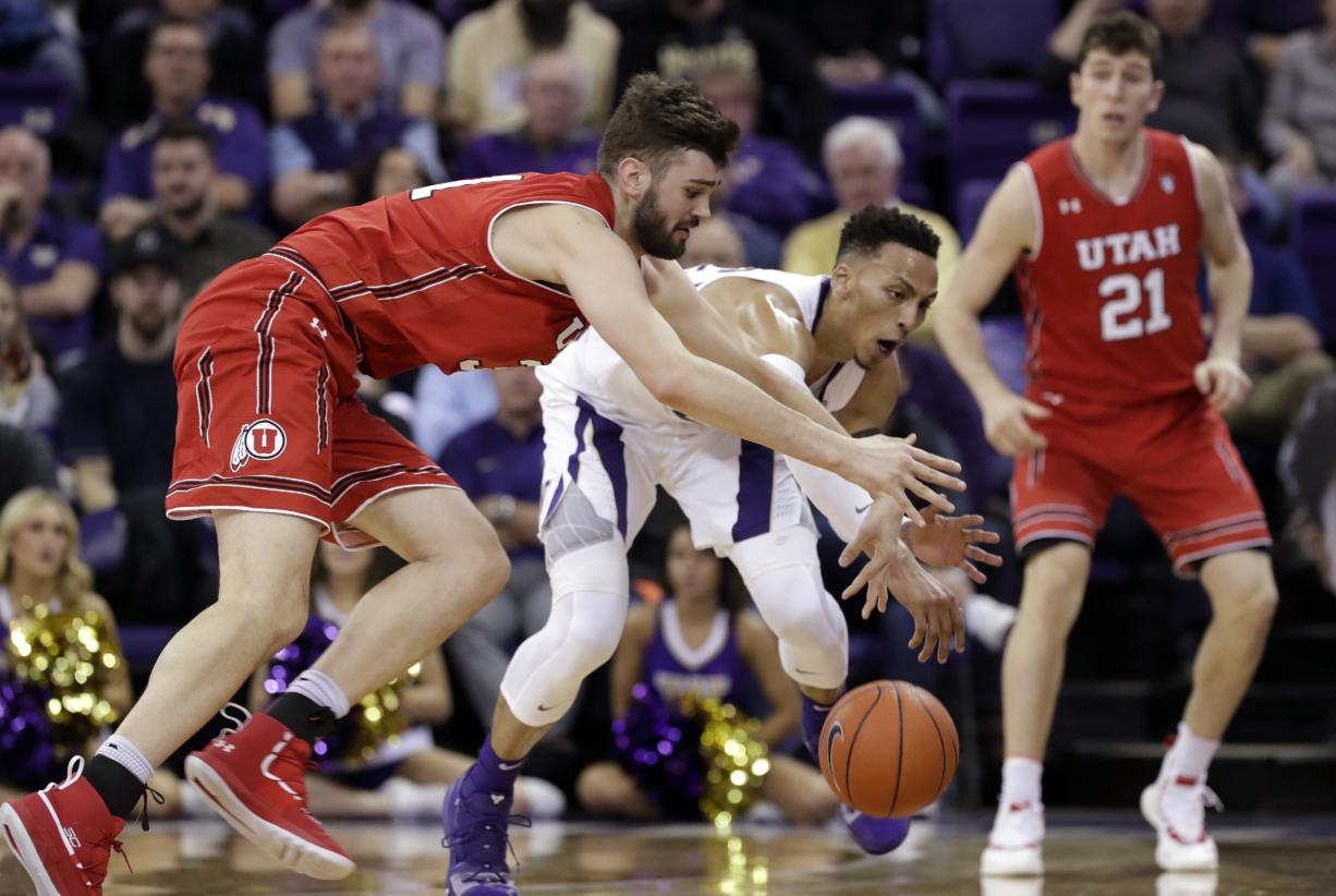 Washington's Dominic Green, center, chases a loose ball with Utah's Brandon Morley, left, as Riley Battin watches during the second half of an NCAA college basketball game Wednesday, Feb. 20, 2019, in Seattle. Washington won 62-45.