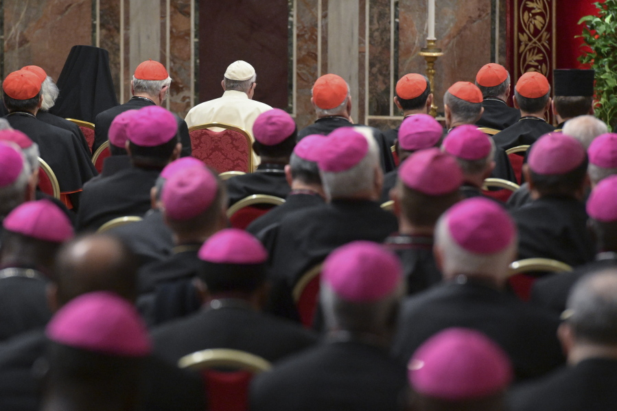 Pope Francis, background third from left, attends a penitential liturgy at  the Vatican,
