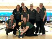 The Evergreen girls bowling team poses with the 3A state trophy at Narrows Plaza in University Place after coming in first for the third straight year.