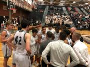 The Union Titans listen to coach Blake Conley in a fourth quarter timeout of a 75-52 win over Sumner in the bi-district playoff on Thursday at Union High School.