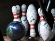 Bowling pins taking a tumble at Allen's Crosley Lanes.