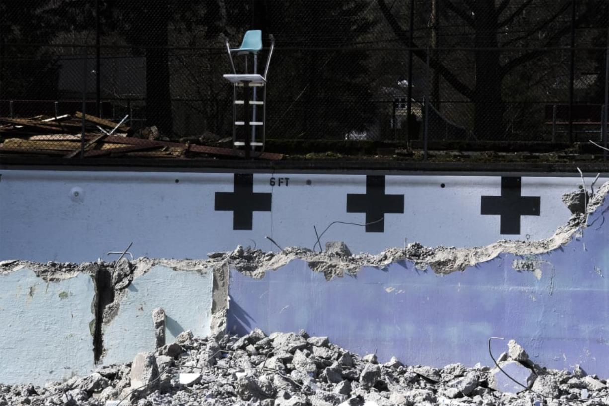 An old lifeguard chair is seen here inside the partially demolished Crown Park pool in Camas on Thursday afternoon. Demolition started this week on the pool, which opened in 1954 but hasn't been in use since summer 2017. The work is expected to be wrapped up by April 1.