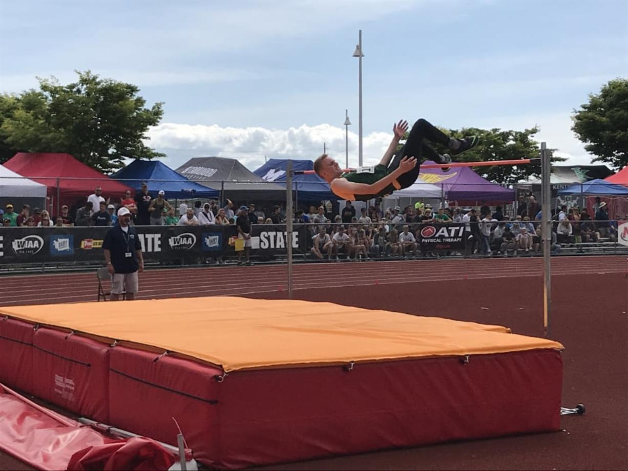 Woodland's Alex Bishop clears the high jump bar en route to placing second at the state meet last spring in Tacoma.