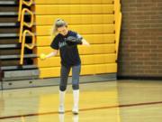 Prairie center fielder Ashley Shelton gathers herself after catching a pop fly during an indoor practice in Prairie High School's gym.