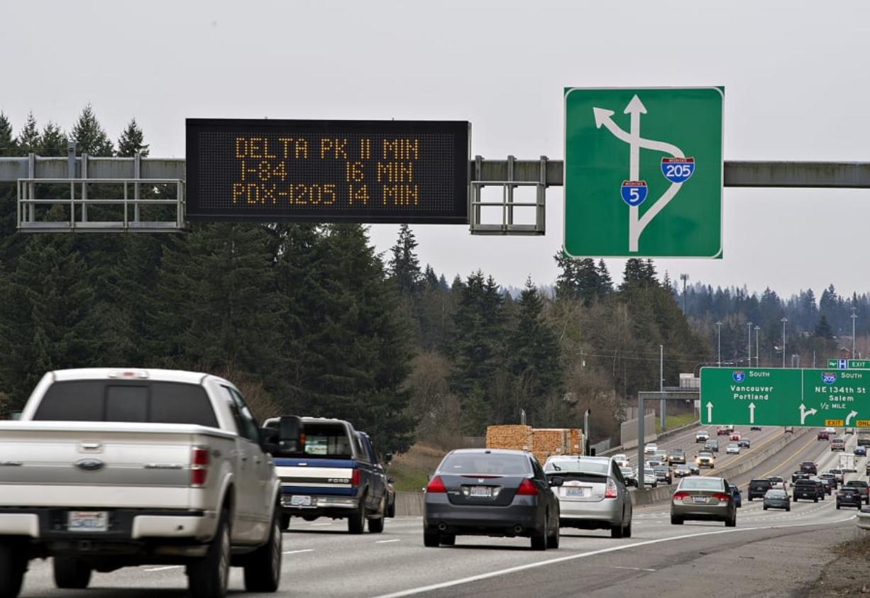 A travel-time sign gives traffic in the southbound lanes of Interstate 5 just south of the Clark County Event Center at the Fairgrounds an estimate for traffic down the road. Signs like these use roadway sensors and radar devices to measure the speed and density of passing traffic, and a computer program uses the information to estimate travel times between two points.