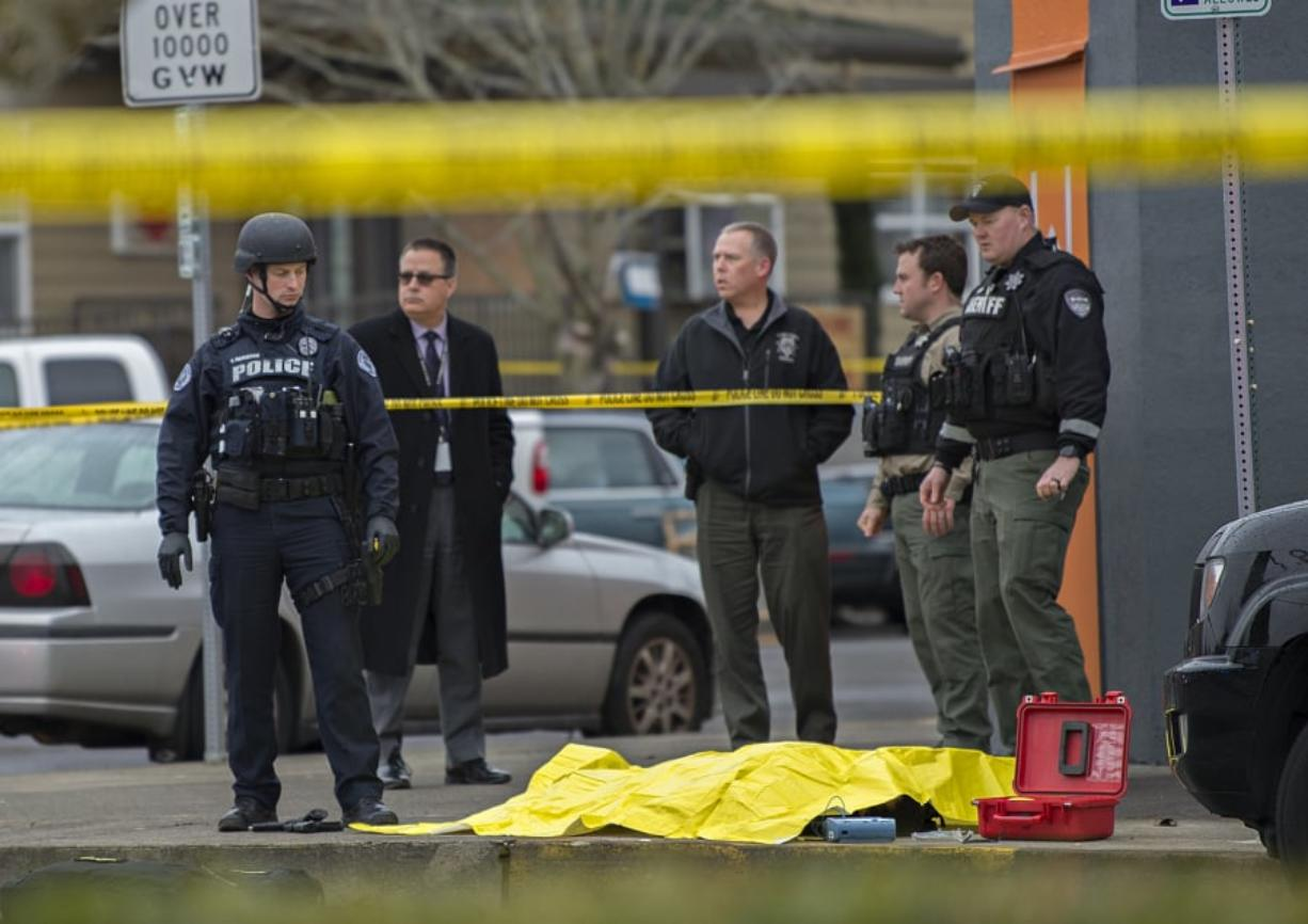 After much discussion, Columbian editors chose this photo of an officer-involved shooting to lead the Friday, March 1 edition.