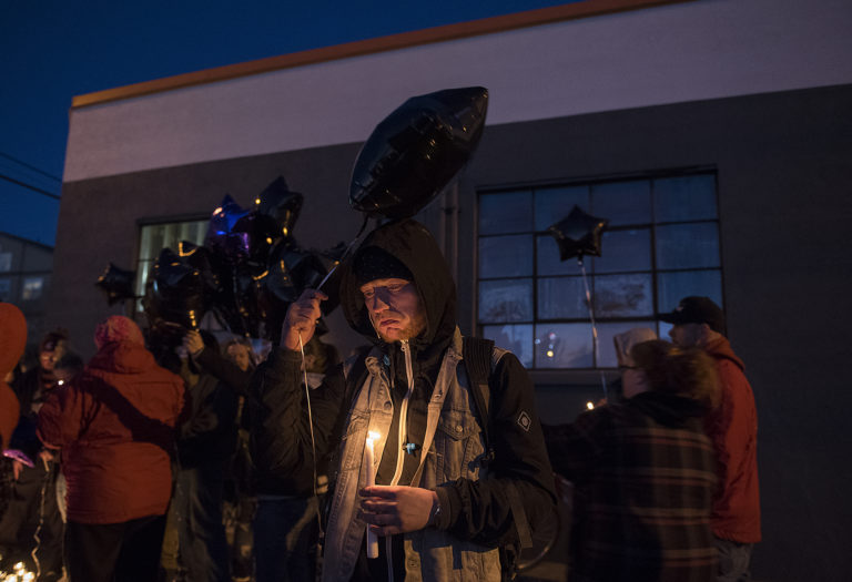 """Braedon Buhler of Vancouver, center, gathers with other friends and loved ones of Michael Pierce as they prepare to release balloons in his honor during a candlelight vigil in downtown Vancouver on Friday evening, March 1, 2019. Buhler said he hoped to see more support for people struggling with mental illness, such as Pierce. He also said he remembered Pierce as a loyal friend. """"If you were his friend, there's nothing he wouldn't do for you,"""" Buhler said."""