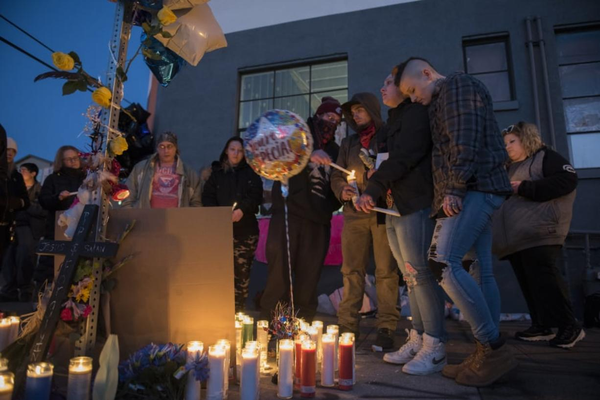 Friends and loved ones of Michael Eugene Pierce gather for an emotional candlelight vigil in his memory Friday evening in downtown Vancouver. About 30 people, many of them homeless, shared memories and jokes about the man Vancouver police officers shot and killed Thursday night.