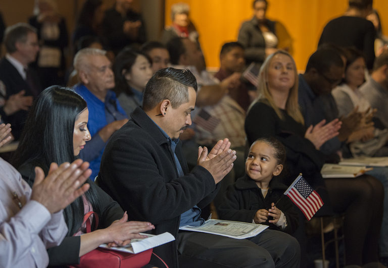 """Mauricio Badillo of Vancouver, who is originally from Mexico, shares a happy moment with his daughter, Gisselle, 2, after officially becoming an American citizen during the Naturalization Ceremony at Vancouver Community Library on Thursday morning, March 7, 2019. Badillo was one of around 40 candidates from 20 countries who received their citizenship during the event. """"It's a great honor to be a part of this country,"""" he said."""