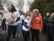 Washougal's Beyonce Bea, from left, celebrates the girls state basketball championship with teammate Kiara Cross and Washougal Mayor Molly Coston at Reflection Plaza in Washougal on Friday morning, March 8, 2019.
