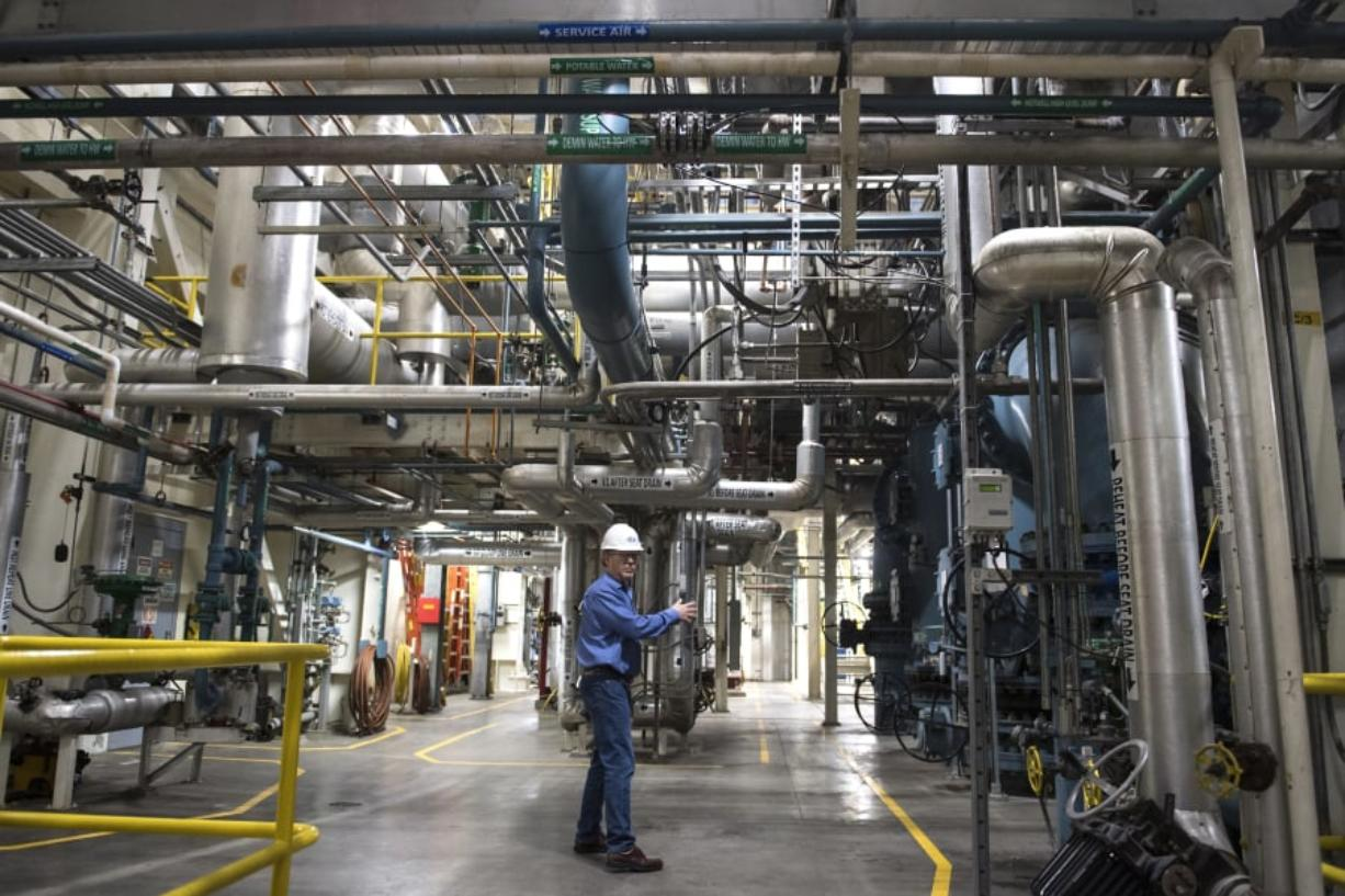Terry Toland, an energy resource manager with Clark Public Utilities, leads a tour of the River Road Generation Plant. A bill in the Legislature exempts the plant from proposed green power requirements.