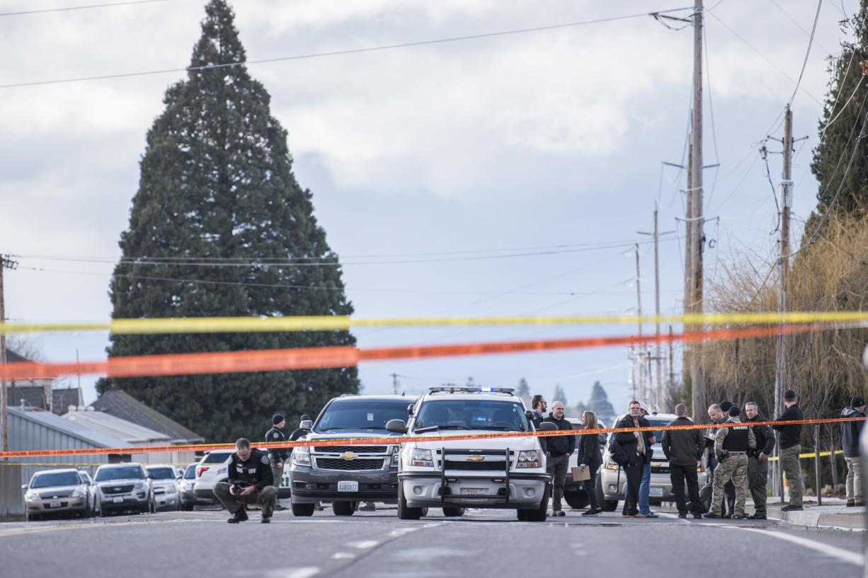 Vancouver Police officers and Clark County Sheriff's Deputies interact at the scene of a police shooting in Hazel Dell on Thursday, March 7, 2019.