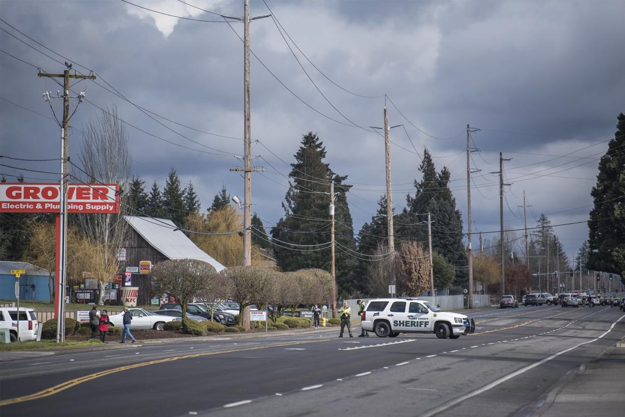 A Clark County Sheriff's cruiser blocks the road leading to the scene of a police shooting in Hazel Dell on Thursday, March 7, 2019.