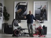 Interim Nautilus CEO M. Carl Johnson III joined the exercise equipment brand's board in 2011. He's standing next to the Bowflex Max Trainer M8, left, which is one of the machines that is linked to a product that may be essential to the company's future success: the Max Intelligence digital platform. At right is a Schwinn Classic Cruiser stationary bicycle.