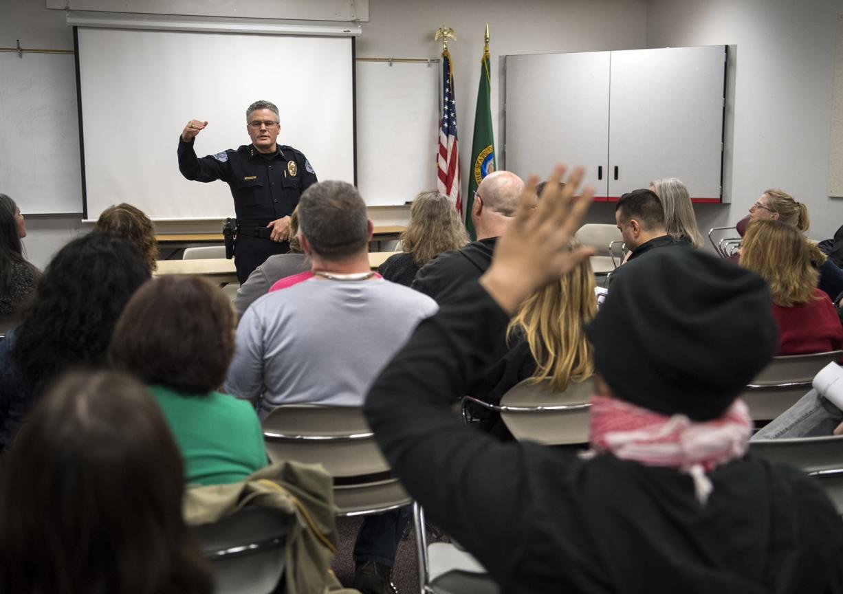 Vancouver Police Chief James McElvain speaks about recent officer-involved shootings during a Vancouver Neighborhood Alliance meeting Wednesday night at Fisher's Landing Fire Station 9.