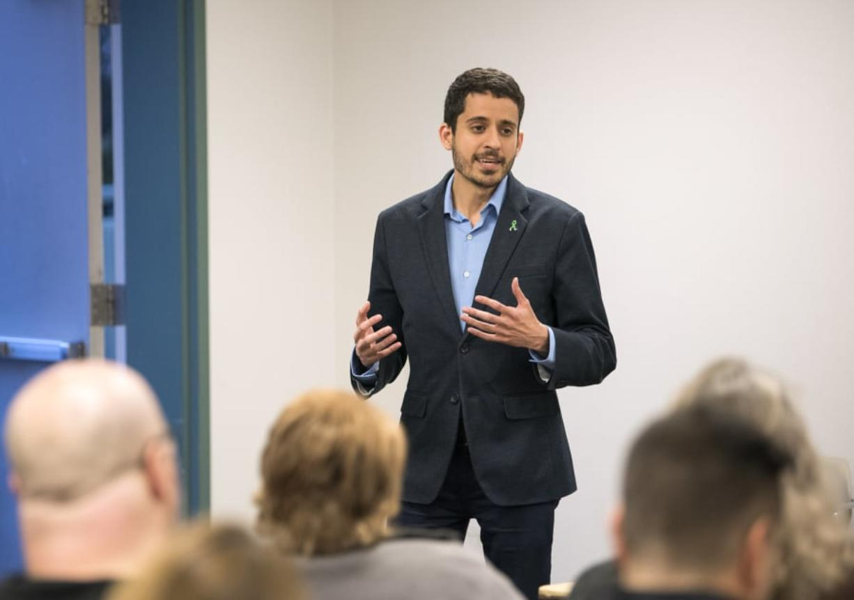 Adam Aguilera, a teacher at Heritage High School and secretary/treasurer for the Evergreen Education Association, announces his candidacy for Vancouver City Council Position 6 during the Vancouver Neighborhood Alliance meeting Wednesday night at Fisher's Landing Fire Station 9 in Vancouver.