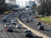 Traffic moves along Interstate 5 near the Rose Quarter in Portland.