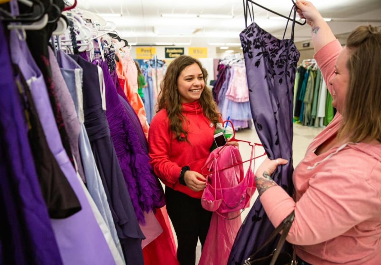 Selena Sanchez, 16, searches for a prom dress with her mother, Jessica Rongone, Saturday during the Project Cinderella event at Evergreen High School in Vancouver.