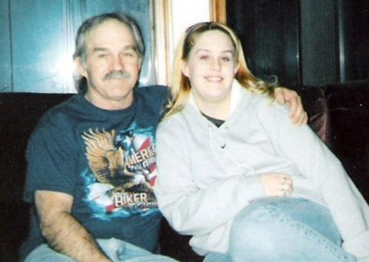 Brandy Jennings and her father in a photo from 2005, four years before his death in 2009. Jennings' desire to find out more about her father prompted her to submit a DNA sample to a public database, which in turn led police to arrest a distant relative for a December 1979 killing in Cedar Rapids, Iowa.