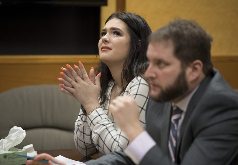 Defendant Tay'Lor Smith, left, fights back tears as her lawyer speaks during her sentencing at the Clark County Courthouse on Wednesday afternoon, March 27, 2019. (Amanda Cowan/The Columbian)