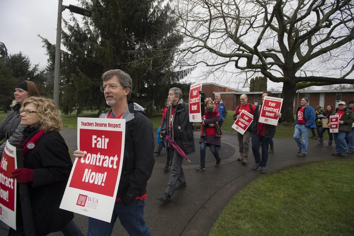 Clark College faculty and supporters prepare to make their way across campus during a Feb. 13 rally for a better contract. The college is convening a task force to consider staff reductions, which the union claims is related to their demands for pay increases.