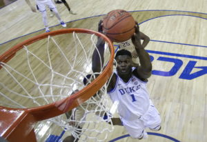 Duke's Zion Williamson (1) goes up to dunk against Florida State during the first half of the NCAA c