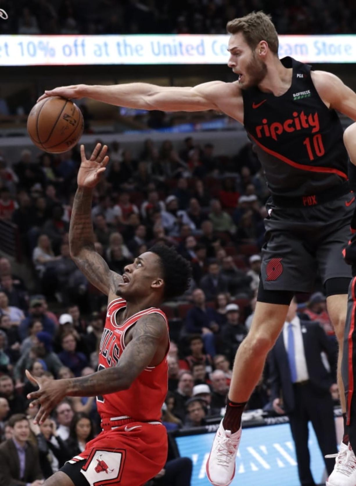 Portland Trail Blazers forward Jake Layman, right, blocks a shot by Chicago Bulls guard Antonio Blakeney during the first half of an NBA basketball game Wednesday, March 27, 2019, in Chicago. (AP Photo/Nam Y.