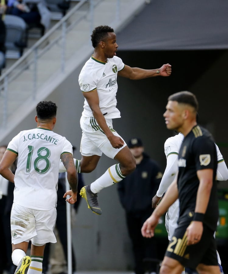 25f50db8e47 Portland Timbers forward Jeremy Ebobisse, center, celebrates his goal  against Los Angeles FC in
