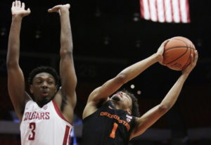 Oregon State guard Stephen Thompson Jr. (1) shoots while defended by Washington State forward Robert