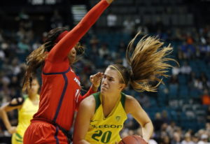 Oregon's Sabrina Ionescu, right, drives around Arizona's Tee Tee Starks during the second half of an